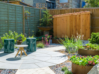 Stylish contemporary garden design with sawn stone circle and sawn sandstone setts