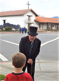 Gen with kid in front of Mission.jpg