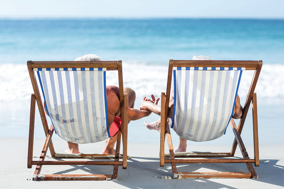Couple relaxing in beach chairs