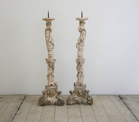 A pair of Rococco candlesticks
