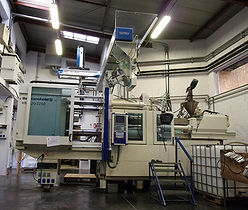 Injection Moulding Machine with an IML Robot