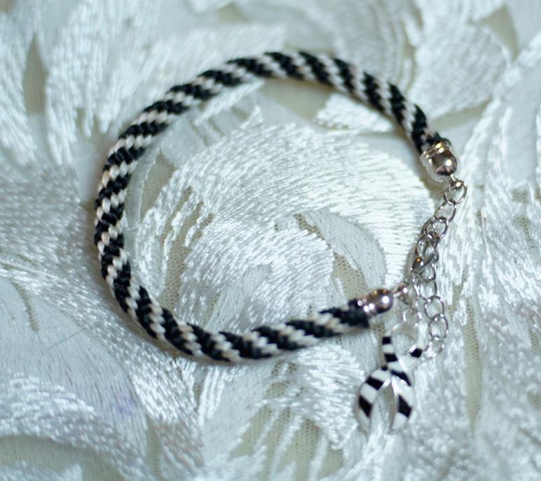 Spiral weave bracelet with Zebra charm