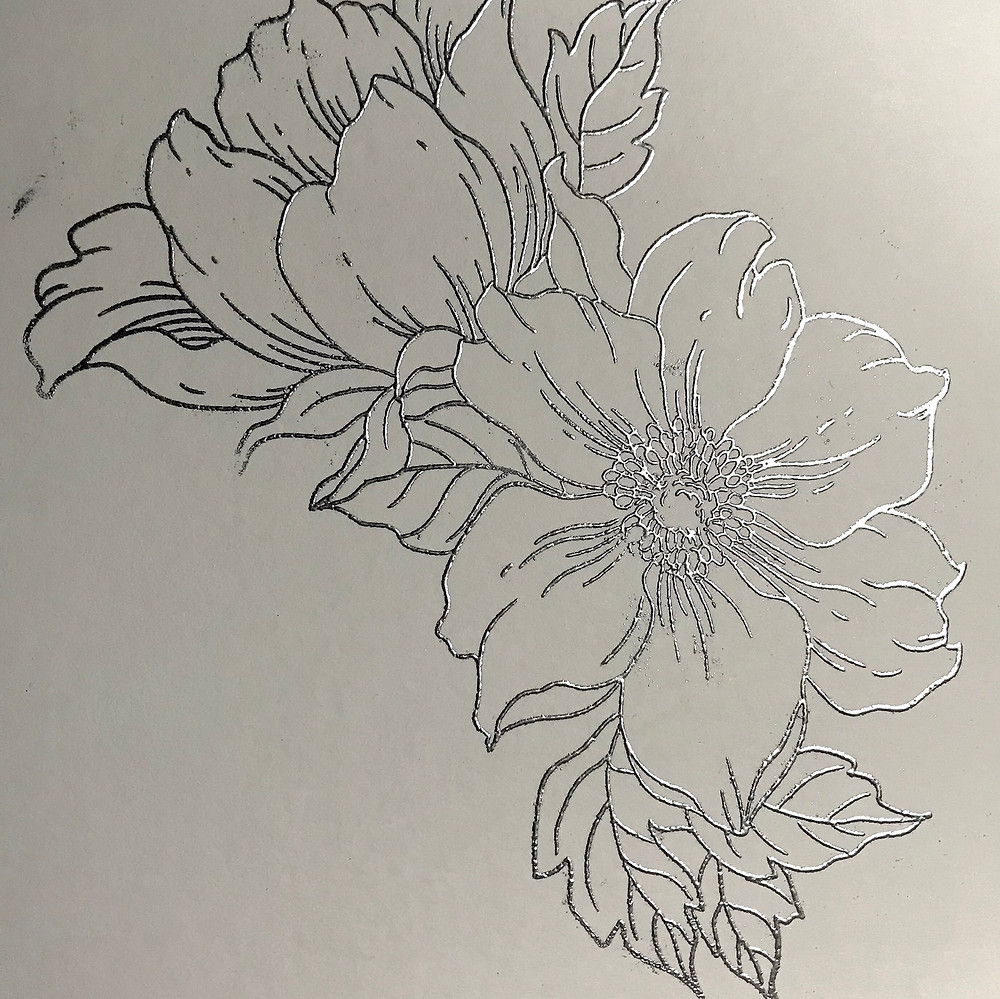 .There's a picture of a very detailed to room flower with leaves that I enbossed Before color it in with watercolors