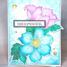 Two large hand stamped #statement flowers colored with waterink.
