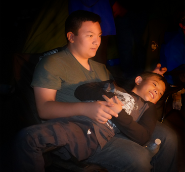 boys at fall campout around the fire.png