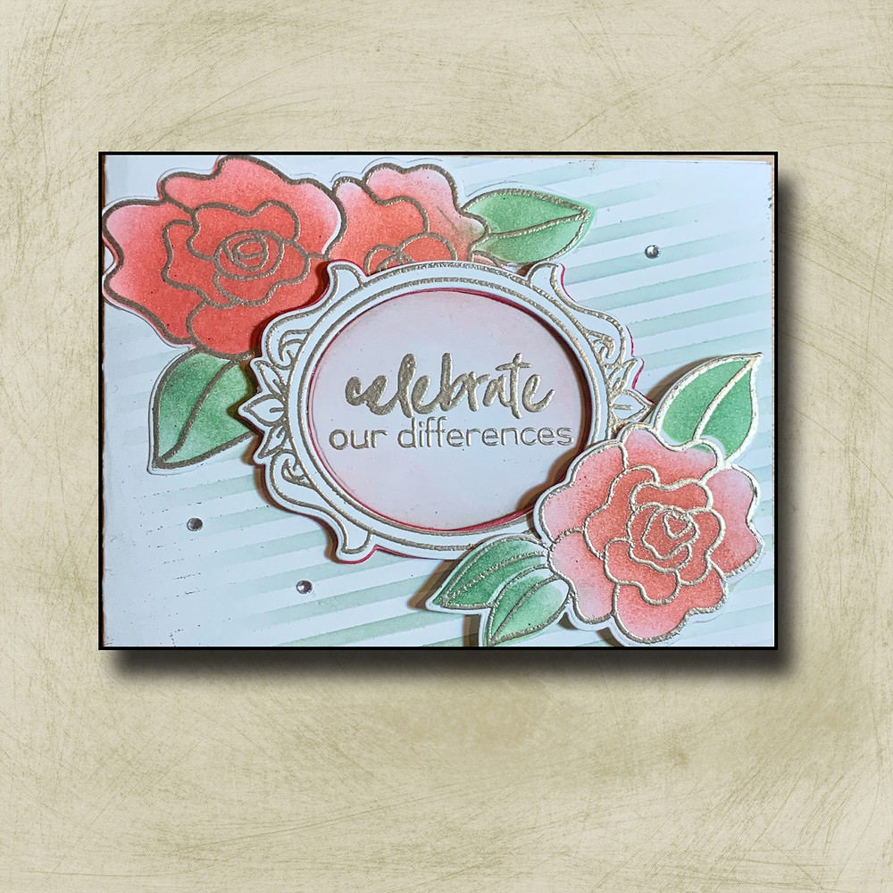This is an image of a card created with several roses, and Boston gold, blended with various colors of red for the flowers and greens for the leaves as well as a lightly pink background and an embossed frame around the sentiment.