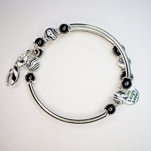 Small wire wrap bracelet with zebra awareness charm, stainless steel beads and z