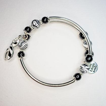 Small wire wrap bracelet with zebra awareness charm, stainless steel beads and z