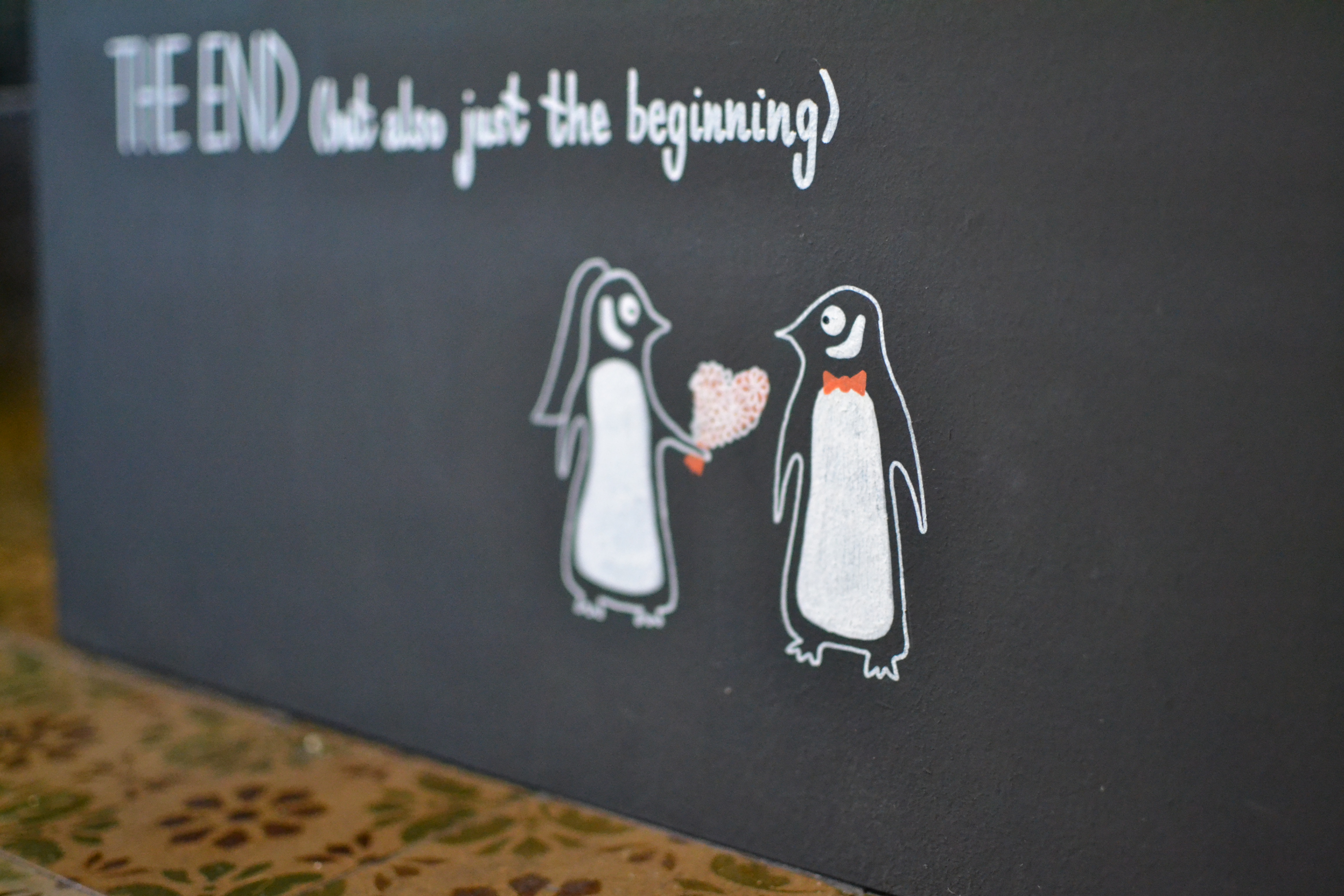 Detail of Penguin Book Timings Sign