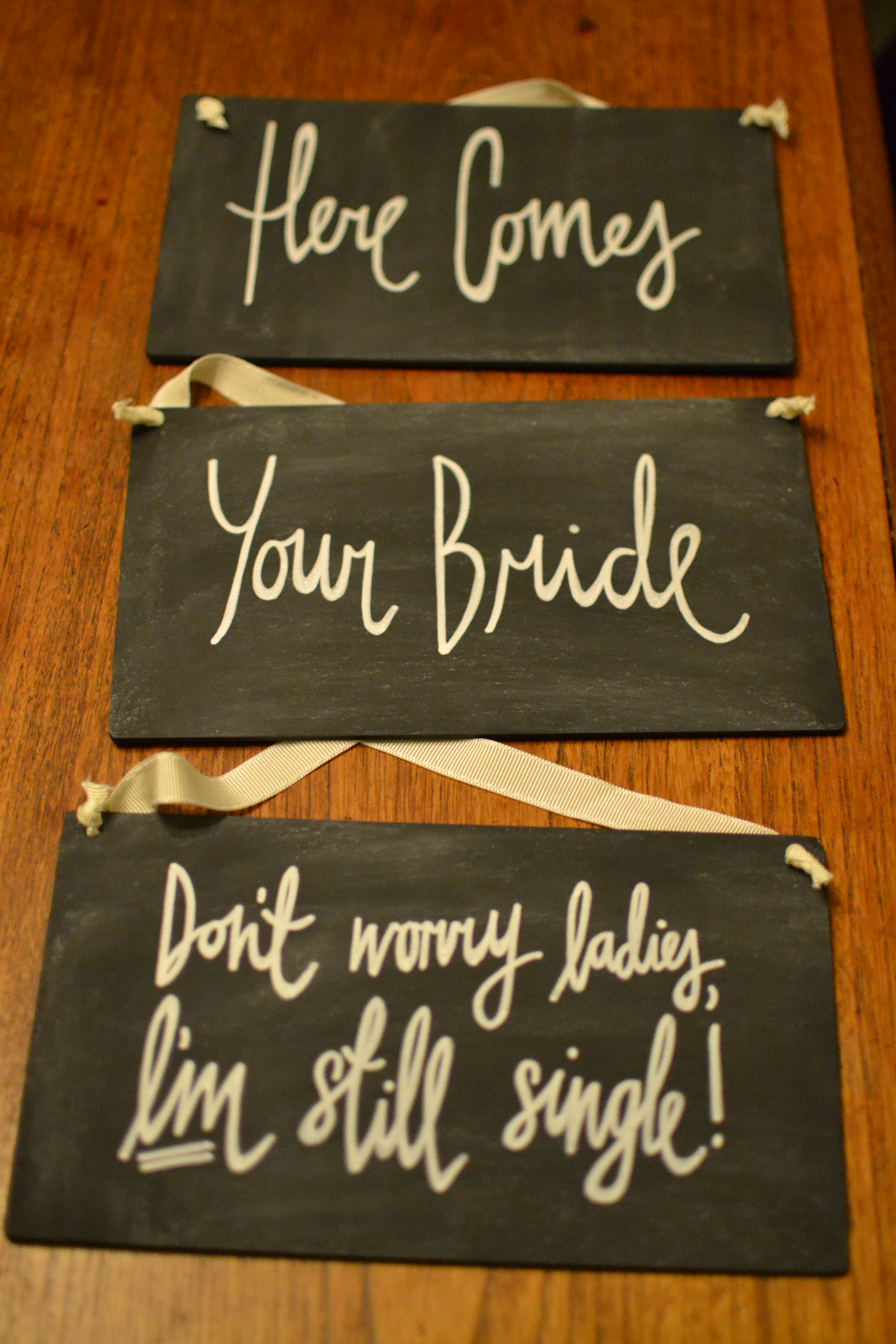 Here comes bride hanging chalkboards