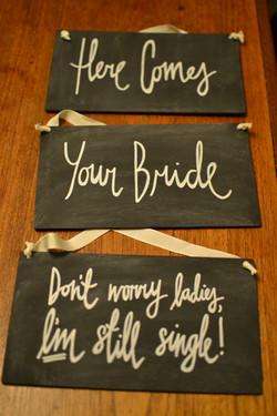 Here comes bride hanging chalkboards