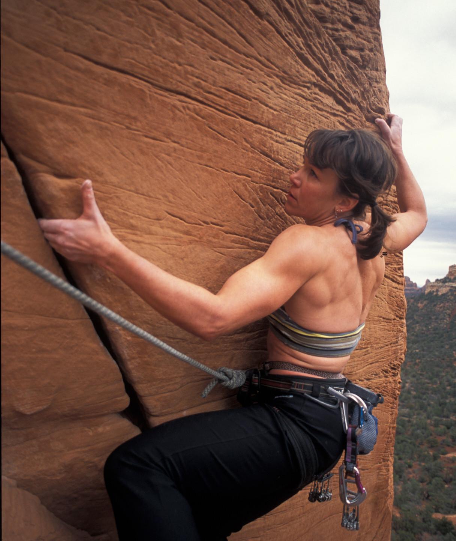 Rebecca climbing rock wall