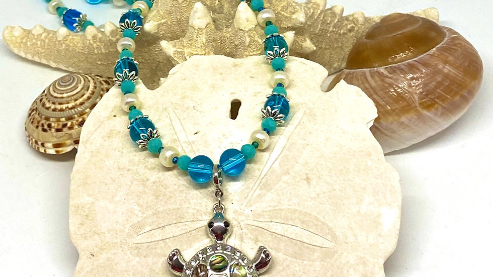 Turtle necklace with freshwater pearls and blue beads
