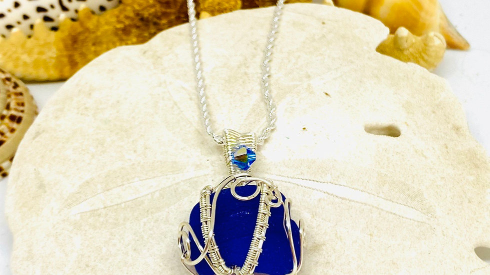 Wire wrapped blue sea glass necklace from Greece
