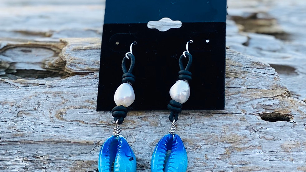 Blue Crowley earrings on leathet