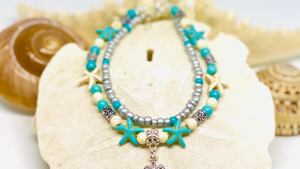 Double anklet with starfish and turtle charm