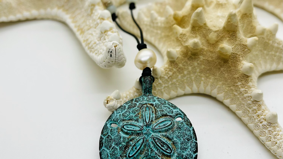 Patina sand dollar on black leather and freshwater pearls AAA quality
