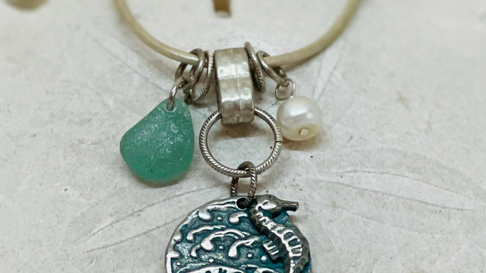 Seahorse charm necklace with charms on beige leather