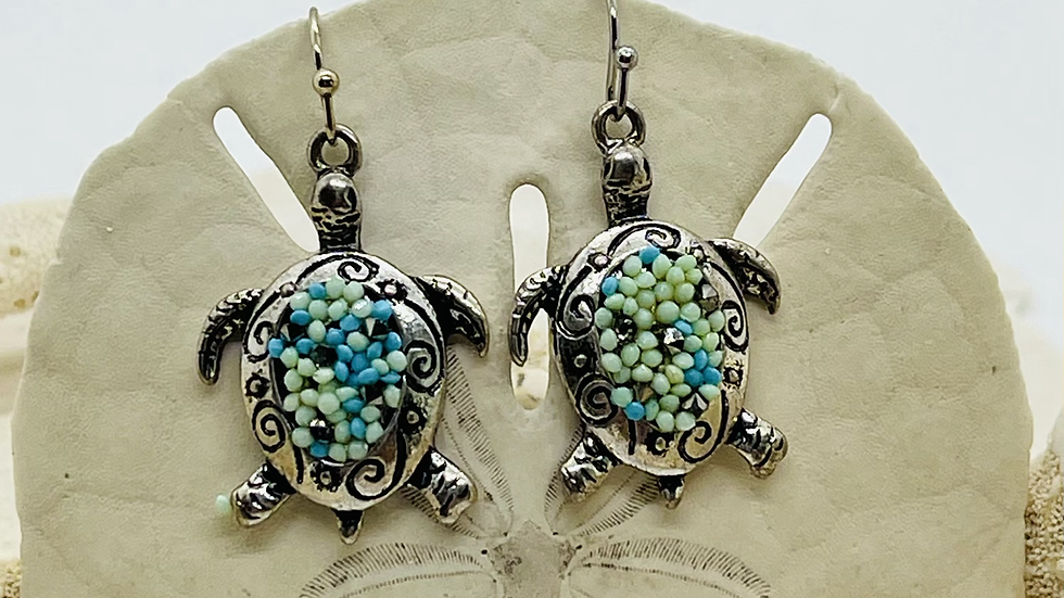 Beautiful turtleEarrings With blue and green confetti