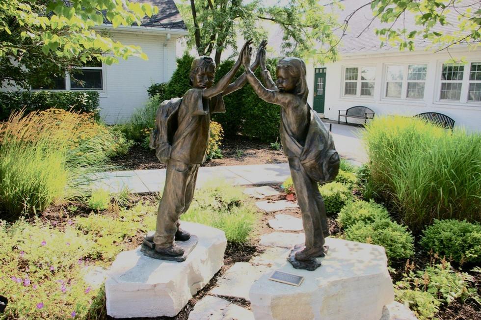 Life-size casr bronze sculpture of children done for Bannockburn School, Bannockburn IL.