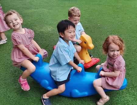 Grade 1 & KG 3 students play in the garden