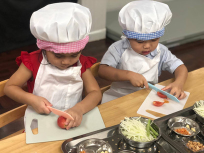 Students enjoying cooking class at Storytime