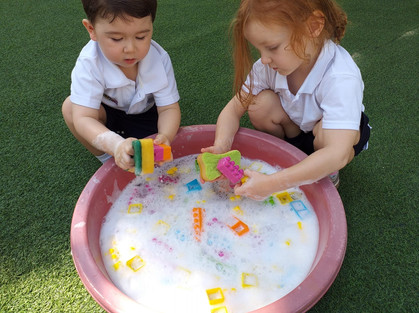 Kg1 students wash toys