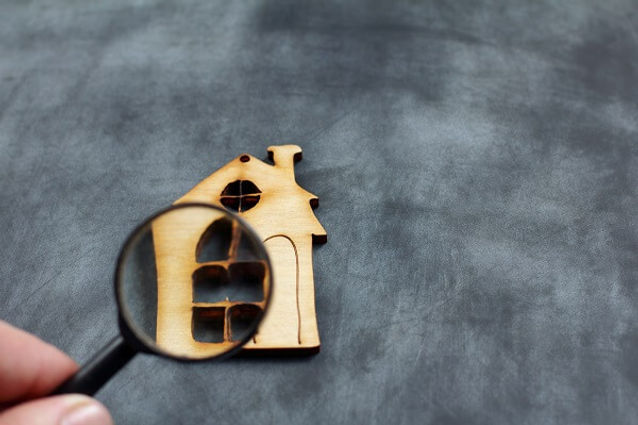 house_under_magnifier__home_inspector_co