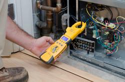 Technician Checking Compressor Amps