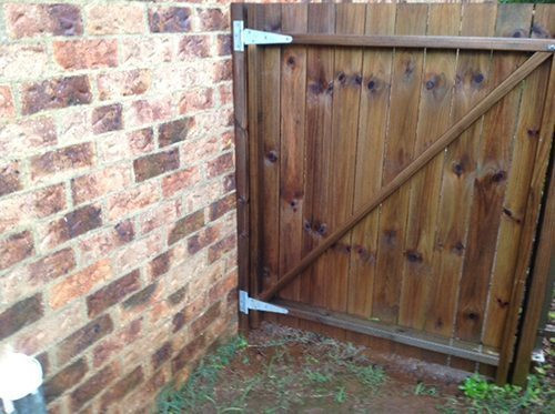 Wood Fence Bolted to Structure