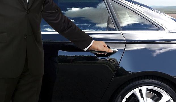 Driver hand opening car door.jpg