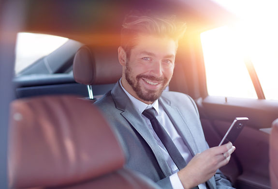 businessman smiling minicab service