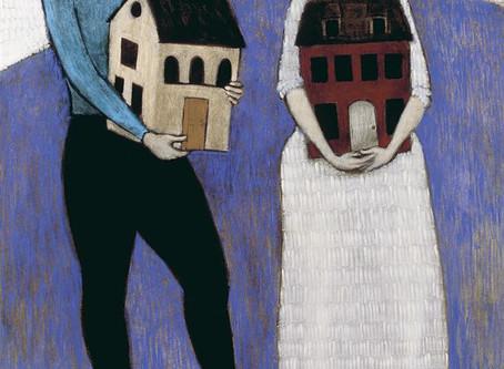 women holding houses