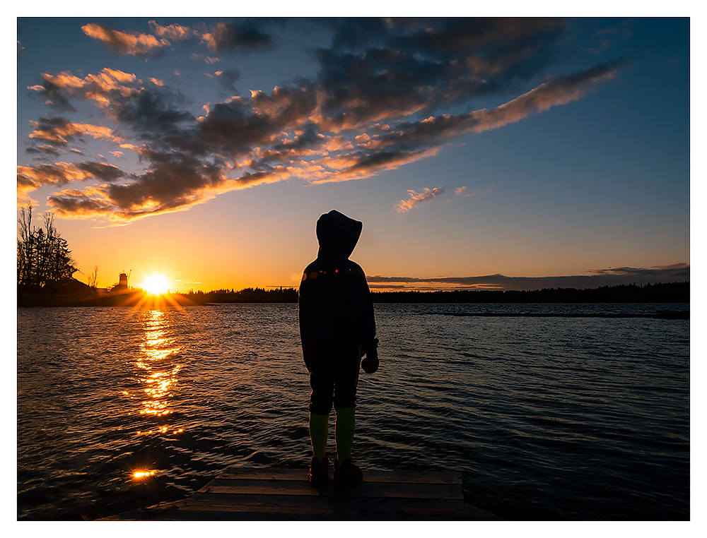 sunset with boy in foreground