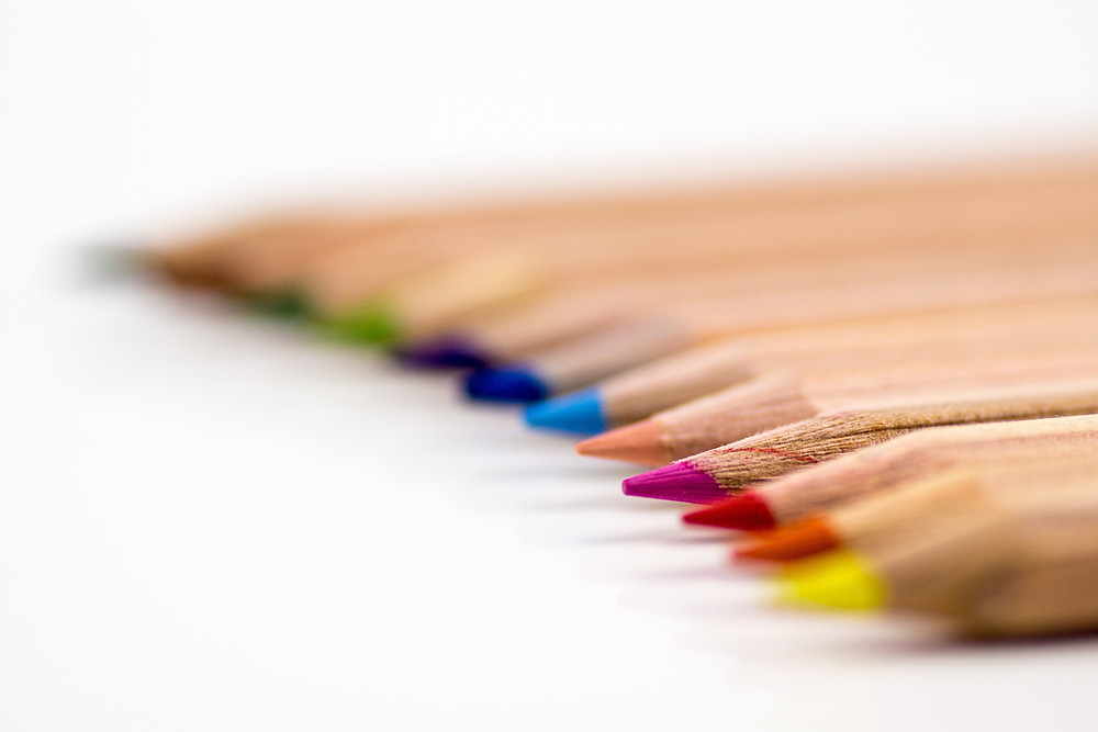 an arrangement of different coloured colouring pencils
