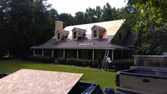 Progress picture of large 30yr arch shingle roof replacement contract