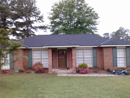 Rustic black 30yr arch heritage shingle roof w/ black drip metal
