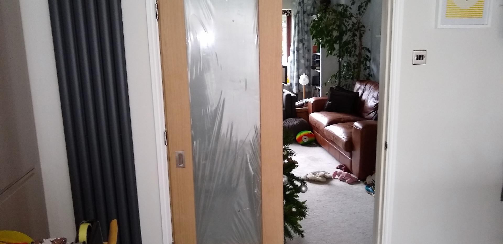 Bi-folding glazed oak door