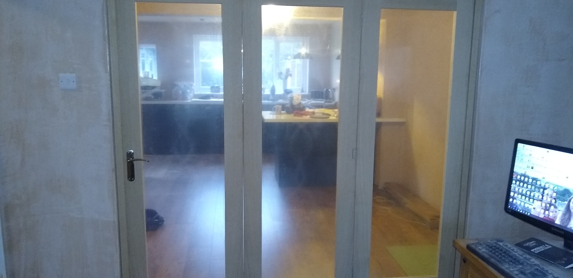 3-panelled glazed oak bi-folding door