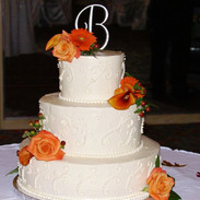 Peach accent wedding cake