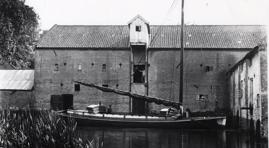 A wherry unloading at Aylsham Mill