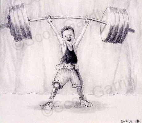 young boy lifts heavy weights (c) Scott Garrity