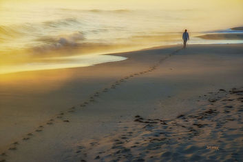 sunset, sand beach, ocean, girl walking, footpprints