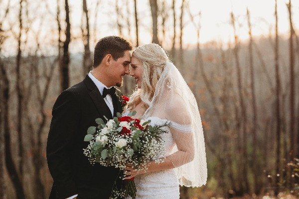 newly married couple touching foreheads after ceremony