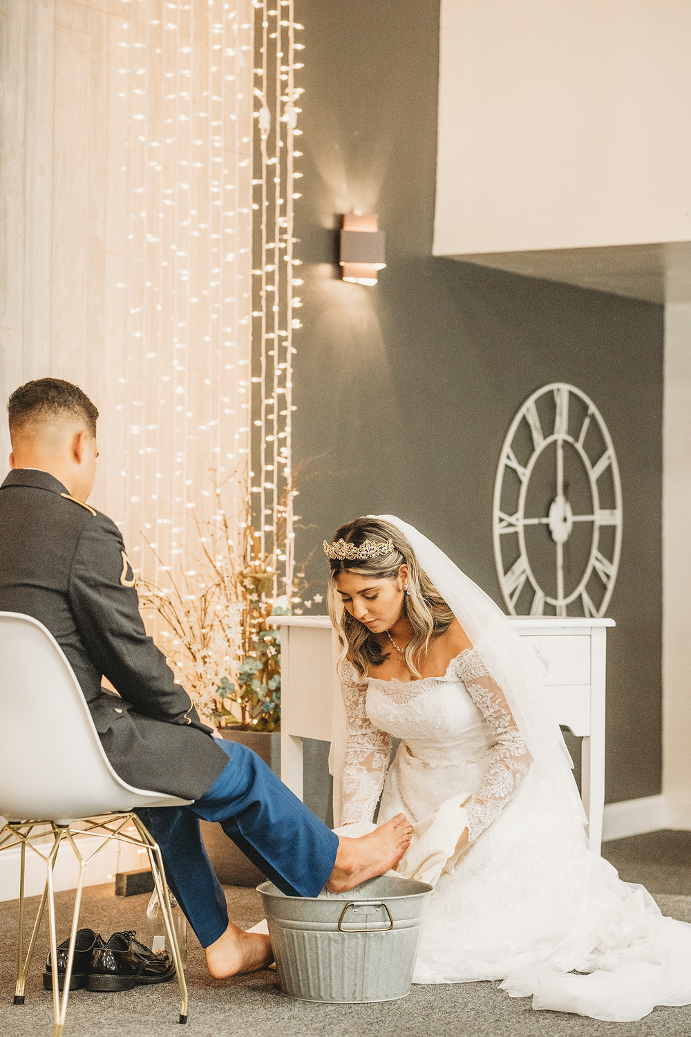 bride washing her grooms feet at ceremony