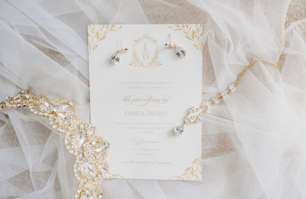 wedding day invites laying on veil