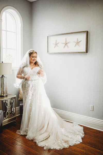 bride standing in corner of room excited to get married