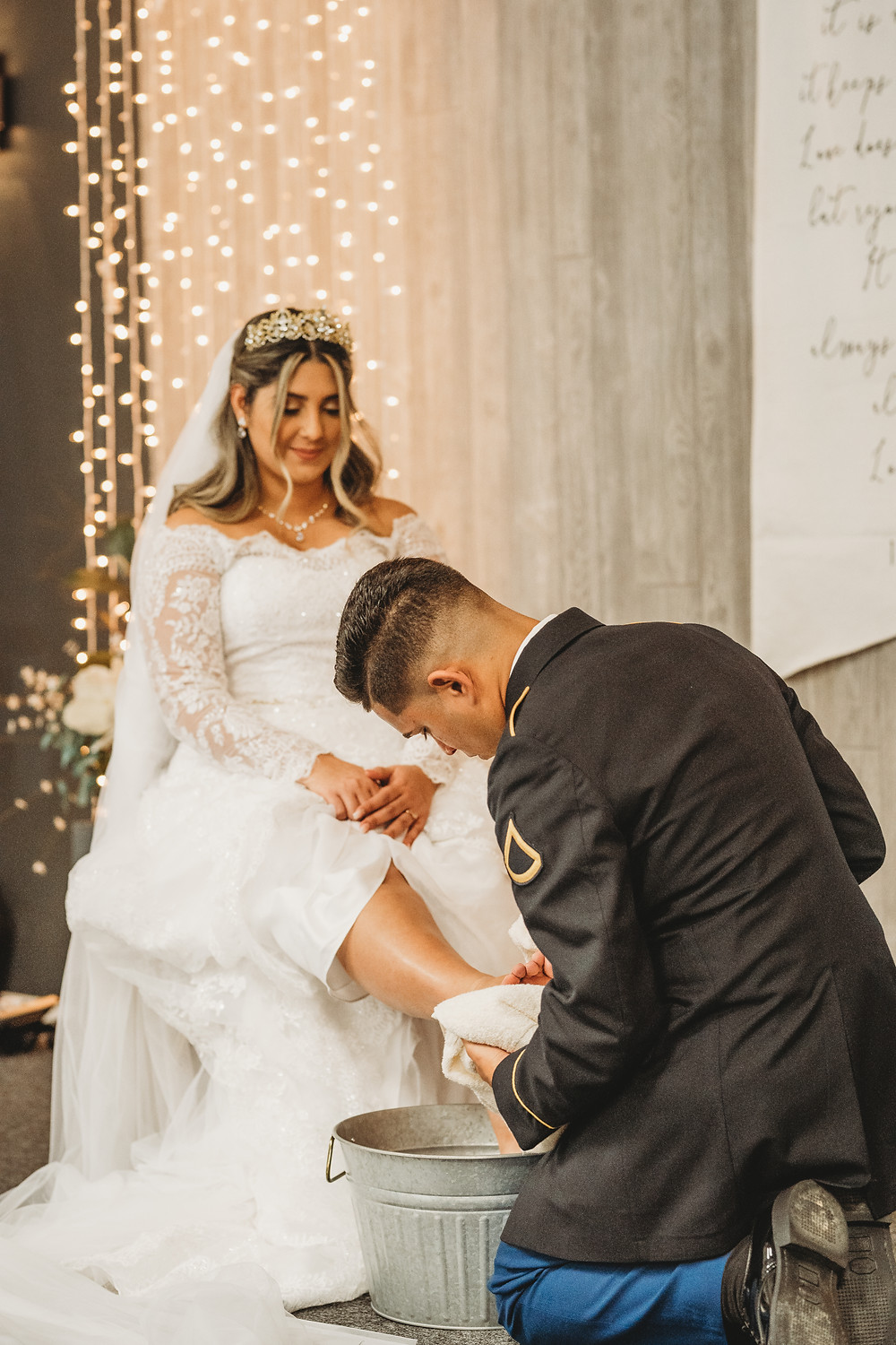 groom washing his brides feet at ceremony