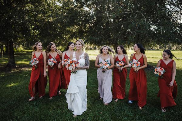 bridesmaids walking on grass