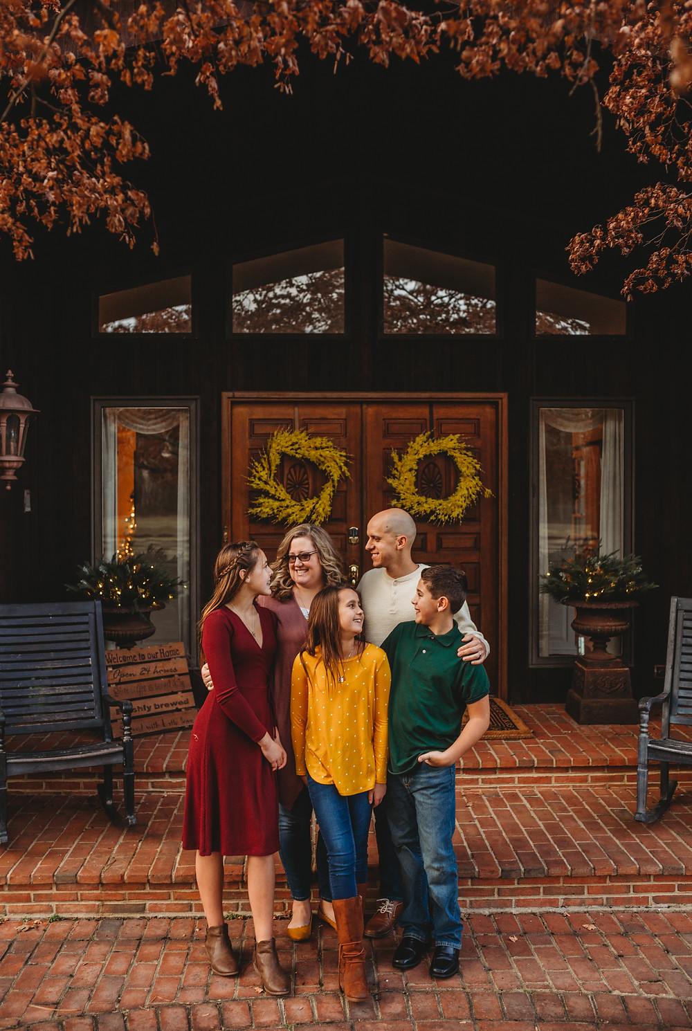 family photo on front porch in fall weather